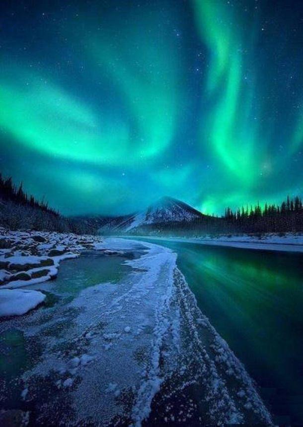 Schitterende Aurora Borealis boven de Ogilvie Mountains, Yukon Territory, 19 januari (bron: Marc Adamus).